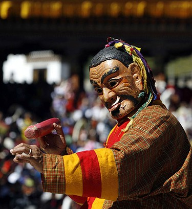 A Bhutanese dancer takes part in the annual Tsechu festival in Thimphu Sept. 28, 2009. The biggest masked dance festival of the year in Bhutan features fancifully costumed dancers performing masked dance-dramas, also the dates and the duration of the festival vary from one district to another REUTERS/Singye Wangchuk