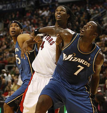 Toronto's Chris Bosh is held back on a freethrow attempt by Dominic McGuire (5) and Andry Blatche (7) during a preseason NBA basketball game at the ACC on Oct. 11, 2009. (JACK BOLAND, Sun Media)