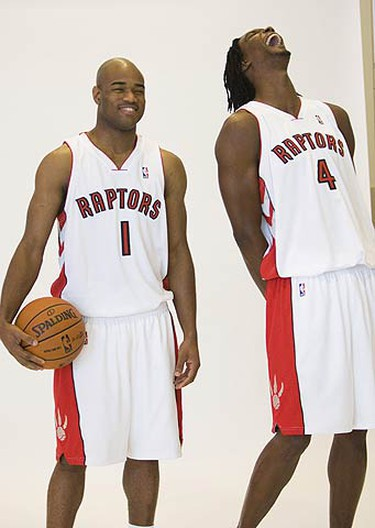 Chris Bosh jokes around with Jarrett Jack during a photo session at Raptors Media Day at the ACC on Sept. 28, 2009. (STAN BEHAL, Sun Media)