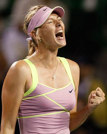 Maria Sharapova, of Russia, reacts after winning the second set against Francesca Schiavone, of Italy, during their first round match at the Pan Pacific Open tennis tournament in Tokyo on Sept. 28, 2009. (REUTERS)
