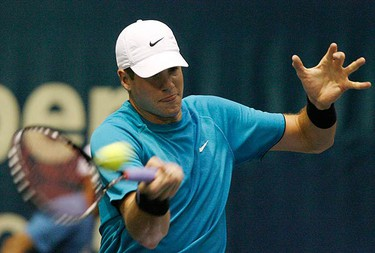 John Isner, of the U.S., returns a shot to Kittipong Wachiramanowong, of Thailand, during their first round match at Thailand Open tennis tournament in Bangkok on Sept. 28, 2009. (REUTERS)