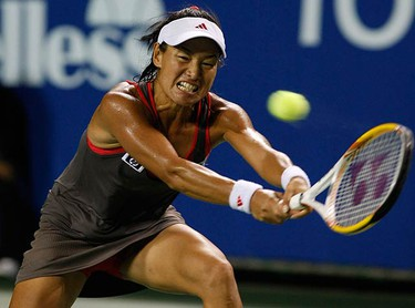 Kimiko Date Krumm, of Japan, returns the ball to Aleksandra Wozniak, of Canada, during their first round match at the Pan Pacific Open tennis tournament in Tokyo on Sept. 28, 2009. (REUTERS)