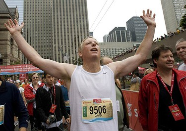 Mayor David Miller at the finish line of the Toronto Waterfront Half Marathon held in downtown Toronto on Sept. 27, 2009.  (STAN BEHAL, Sun Media)