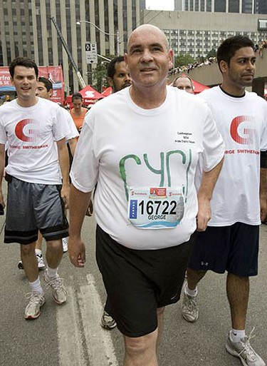 George Smitherman at the finish line of the Toronto Waterfront 5K held in downtown Toronto on Sept. 27, 2009. (STAN BEHAL, Sun Media)