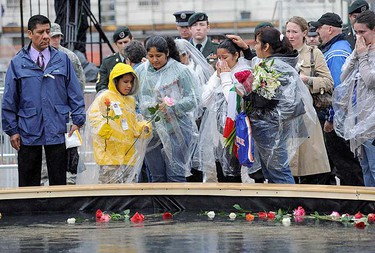 Family members of Sept. 11 attack victims pay their respects at the reflecting pool at Ground Zero during the eighth anniversary commemoration ceremony of the 9/11 attacks on the World Trade Center in New York, Sept. 11, 2009.   REUTERS/David Handschuh/Pool