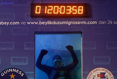 Cem Karabay achieves a Guinness World Record for scuba diving in Istanbul on Sept. 4, 2009. Turkish diving instructor Karabay broke a Guinness World Record for the longest time spent scuba diving in fresh water. The 37-year old diver stayed under water for five days, breaking the old record. He aims to remain under water for a total of 10 days in a specially-constructed aquarium.  (REUTERS)