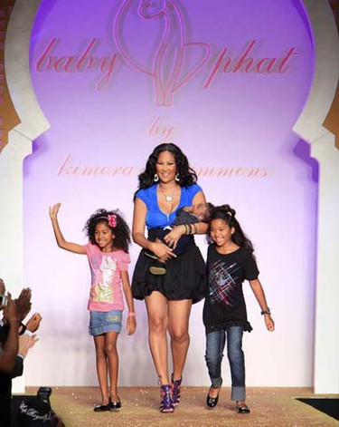 Designer Kimora Lee Simmons and her children greet the audience after the presentation of the Baby Phat 2010 collection during New York Fashion Week Sept. 15, 2009. (Cary Horowitz/REUTERS)