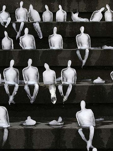 Ice sculptures in the shape of humans are placed on the steps of the music hall in Gendarmenmarkt  public square in Berlin Sept. 2, 2009. REUTERS/Tobias Schwarz