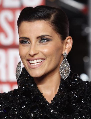 Singer Nelly Furtado arrives at the 2009 MTV Video Music Awards in New York, September 13, 2009.     REUTERS/Eric Thayer (UNITED STATES ENTERTAINMENT)
