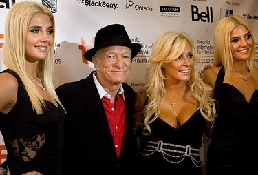 Hugh Hefner arrives with his twin playmate girlfriends on the TIFF red carpet at The Elgin Theatre for the screening of Hugh Hefner: Playboy, Activist, Rebel on Sept. 12, 2009. Also in the group is the movie's director Brigitte Berman. (STAN BEHAL, Sun Media)