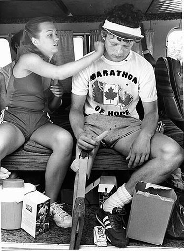 Marathon runner Terry Fox gets a cool towel applied to his neck by a girl working on his run across the country.  (SUN MEDIA FILES)