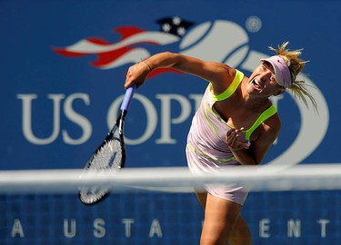 Maria Sharapova of Russia serves to Melanie Oudin of the U.S. during their match at the U.S. Open tennis championship in New York on Sept. 5, 2009. (REUTERS)
