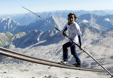 Freddy Nock, from Switzerland, balances on the ropeway of a cable car leading on Germany's highest mountain, the 2,962 metre (9,718 feet) Zugspitze in front of the panorama of the Alps, near the southern Bavarian resort of Garmisch-Partenkirchen on Aug. 30, 2009. Nock balanced on the 995 metre-long rope to break a world record as part of a charity event.  (REUTERS)