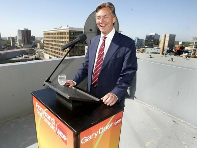 Premier Gary Doer smiles during a press conference about the east-west power grid. He resigned from his position today. (SUN MEDIA)