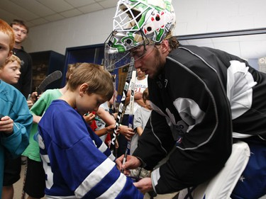 "Leafs puckstopper Jonas ""The Monster"" Gustavsson signs some autographs with kids from the Hockey 101 summer camps after  practice at Lakeshore Lions Arena. (JACK BOLAND/Sun Media)"