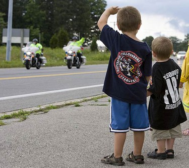 Motorcycles, escorted by 33 officers from GTA police crews and officers from as far away as New Jersey supported Canada's 911 Ride Foundation's Charity Motorcycle ride. The foundations mission is to host an annual police escorted motorcycle ride to raise funds and awareness to help families of fallen emergency service personnel and children who are victims of crime. (GREG HENKENHAG, Sun Media)