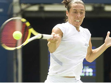 Francesca Schiavone of Italy beat France's Amelie Mauresmo in three sets, 6-2, 3-6, 6-1, to advance in Rogers Cup Tennis at York University's Rexall Centre Monday (STAN BEHAL, SUN MEDIA)
