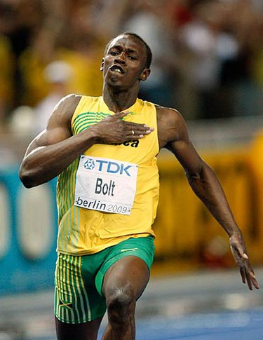 Jamaica's Usain Bolt celebrates winning the final setting a new 100m World Record  during the World Athletics Championships in Berlin on Aug. 16, 2009.  Bolt won the final setting a new 100m World Record.