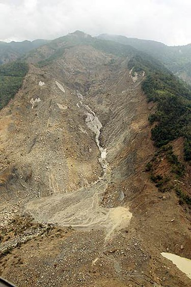 The village of Hsiaolin is buried by a landslide following Typhoon Morakot in Kaohsiung county, southern Taiwan on Aug. 14, 2009. (REUTERS)