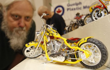 Ric Moellers, of Oakville checks out a tiny scale-model custom bike made by Guelph Plastic Modeller's Group. (Jack Boland/Toronto Sun)