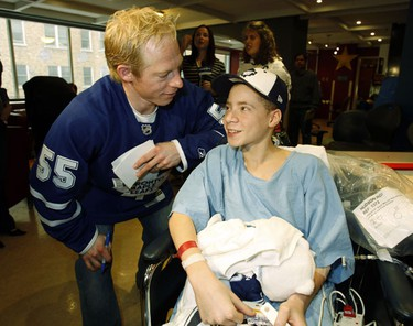 Toronto Maple Leaf player Jason Blake meets Matthew Mitchell.  Mitchell has had three surgeries at the hospital. The Leafs paid their annual visit to the Hospital today. (Craig Robertson/Toronto Sun)