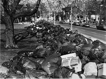 Garbage is piled high on the streets of Toronto in this 1972 residential photo. (SUN MEDIA FILES)