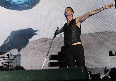 """Lead singer David Gahan prepares to bow to the crowd after their foruth song, """"Walking,"""" before a packed house. (JACK BOLAND, Sun Media)"""
