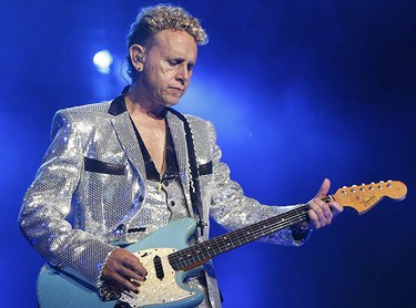 """Guitarist Martin Gore looks all sparkly during  their second song """"Wrong,"""" before a packed house. (JACK BOLAND, Sun Media)"""