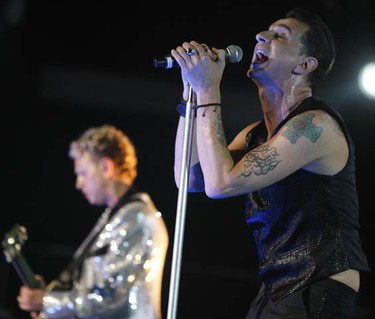 """Lead singer David Gahan (L) and Martin Gore (R) groove on their second song """"Wrong."""" (JACK BOLAND, Sun Media)"""