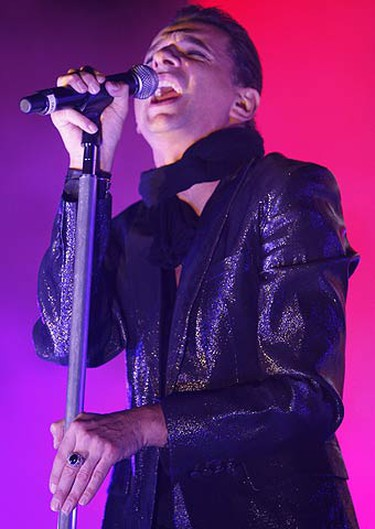 """Lead singer David Gahan launches into their first song of the night """"In Chains."""" (JACK BOLAND, Sun Media)"""