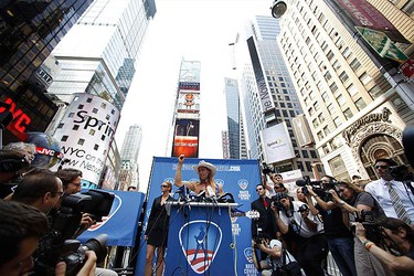 """Robert Burck, a street performer known as the """"Naked Cowboy,"""" declares his candidacy for Mayor of New York City in Times Square on July 22, 2009. A fixture in Times Square for a decade, Burck has made a profitable business from strumming a guitar dressed only in cowboy boots, a hat and tight-fitting white briefs, asking tourists to pay a fee to take a picture with him. The Naked Cowboy vowed to run a transparent campaign. (REUTERS)"""