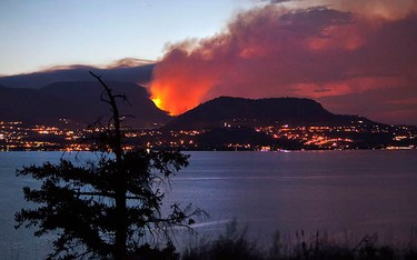 A forest fire burns on the edge of Kelowna, British Columbia, northeast of Vancouver at dawn on July 19, 2009. (REUTERS)