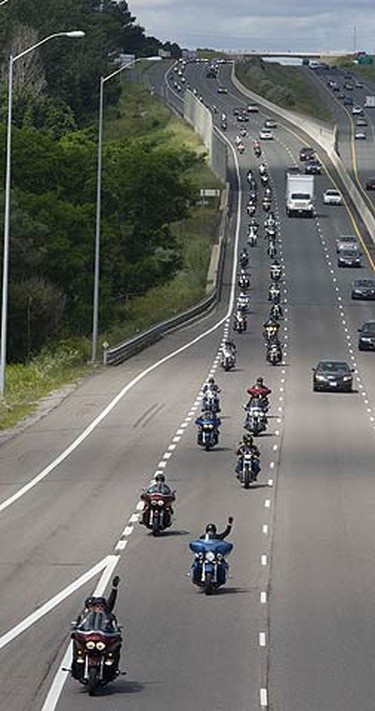 Over 300 riders head east along Hwy. 401 from Grafton after having lunch in Cobourg in the first annual Highway of Heroes Salute Ride from Whitby to CFB Trenton. (PETE FISHER, Sun Media)
