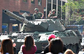A Leopard tank and its crew take part in the Capital EX Parade. (EDMONTON SUN FILE)