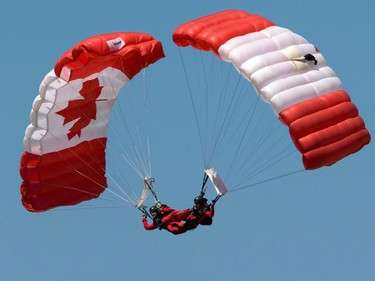 The Canadian Forces Skyhawks parachute team races to earth during the Anniversary Weekend at CFB Trenton on Sunday.  A number of military aircraft took to the skies for the air show, including a Globemaster, and CF-18 fighter jet, along with the Canadian Forces Snowbirds. (PETE FISHER/SUN MEDIA)