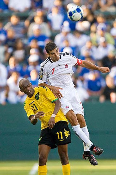 Canada's Paul Salteri (R) goes up for a header against Jamaica's Luton Shelton in the second half of a CONACAF Gold Cup soccer match in Carson, California on July 3, 2009. (REUTERS)
