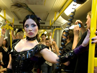 "A model presents a creation by Savage Wear during the ""Underground Catwalk"" fashion show in an underground train in Berlin, July 2, 2009. (REUTERS)"