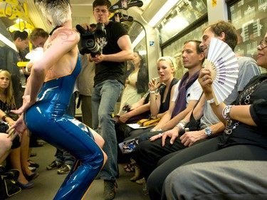 A model presents a creation by Savage Wear during a fashion show in an underground train in Berlin, July 2, 2009. (REUTERS)