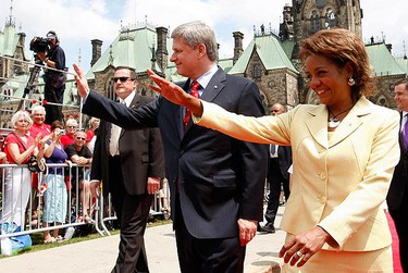 Canada's Governor General Michaelle Jean (R) and Prime Minister Stephen Harper wave during Canada Day celebrations on Parliament Hill in Ottawa on July 1, 2009. Canadians are celebrating their country's 142nd birthday. (REUTERS)