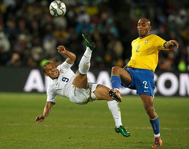 Charlie Davies of the U.S. challenges Maicon of Brazil (R) during the Confederations Cup final soccer match at the Ellis Park Stadium in Johannesburg on June 28, 2009. (REUTERS)