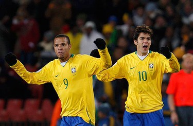 Luis Fabiano of Brazil (L) celebrates with team mate Kaka after scoring a goal against the U.S. during the Confederations Cup final soccer match at Ellis park stadium in Johannesburg on June 28, 2009. (REUTERS)