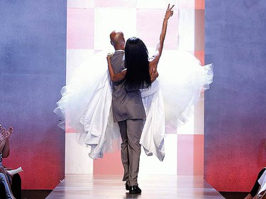 """A model is carried off the runway by contestant Reco during the season finale of Bravo's TV series, """"The Fashion Show"""" in New York, on June 26, 2009.  (REUTERS)"""