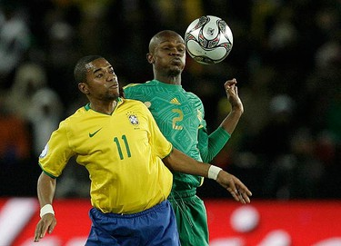 Brazil's Robinho (L) challenges South Africa's Siboniso Gaxa during their Confederations Cup semifinal soccer match at Ellis Park stadium in Johannesburg on June 25, 2009. (REUTERS)
