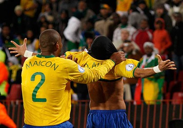 Brazil's Daniel Alves (R) celebrates with team mate Maicon after scoring a goal against South Africa during their Confederations Cup semifinal soccer match at Ellis Park stadium in Johannesburg on June 25, 2009. (REUTERS)