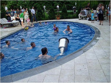 A Stanley Cup party at Mario Lemieux's house with players and their families.
