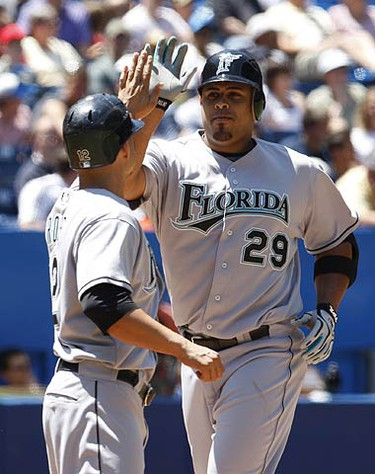 Florida Marlins batter Ronny Paulino celebrates his home run against the Toronto Blue Jays with teammate Cody Ross during the second inning of their MLB interleague baseball game in Toronto on June 14, 2009. (ALEX UROSEVIC, Sun Media)