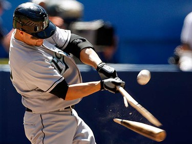 Florida Marlins batter Cody Ross breaks his bat on a fly ball out against the Toronto Blue Jays during the eighth inning of their MLB interleague baseball game in Toronto on June 14, 2009. (REUTERS)
