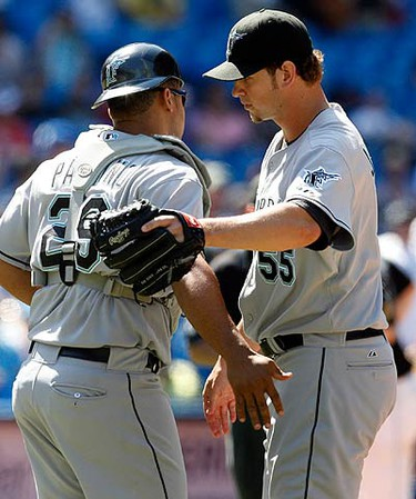 Florida Marlins catcher Ronny Paulino and pitcher Josh Johnson celebrate their win against the Toronto Blue Jays during the ninth inning of their MLB interleague baseball game in Toronto on June 14, 2009. (REUTERS)