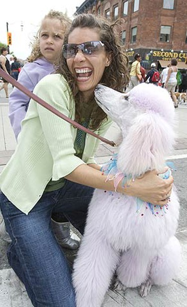 Sierra Blackburn, 3, and her mom Rebecca Shemain with Isis at Woofstock in Toronto. A two-day long festival featuring all things dogs on June 13, 2009. (ALEX UROSEVIC, Sun Media)