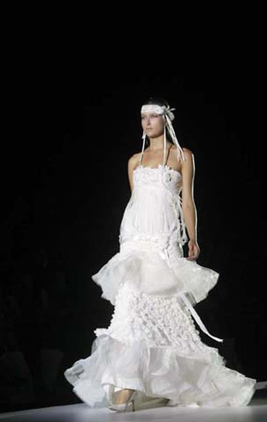 A model presents a creation from the Yolan Cris collection at the Barcelona Bridal Week fashion show June 10, 2009. (Albert Gea/REUTERS)